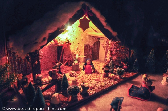 Nativity scene populated by tiny clay figures.