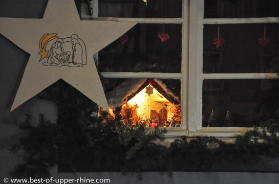 Bergheim, Alsace. Nativity scenes. Christmas 2012. Homes that are displaying cribs are indicated by a white star.